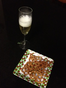 A glass of bubbly to kick the holidays off, with a side order of pretzels. Let the good times roll, people!