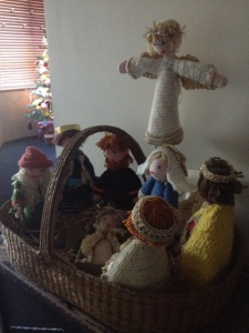 The nativity my Grandma crocheted, complete with a shepherd and three wise men.